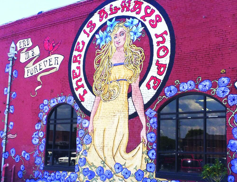 butchertown mural of woman